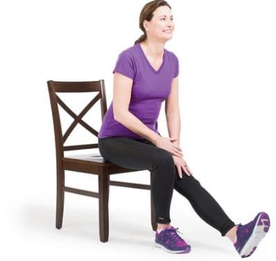 تمرین کشش روی صندلی به حالت نشسته برای دیسک کمر